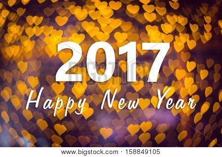 2017 Happy New Year background with orange heart bokeh