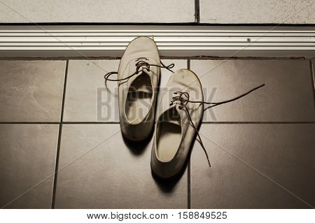 Old shoes at the front door , Vintage Style
