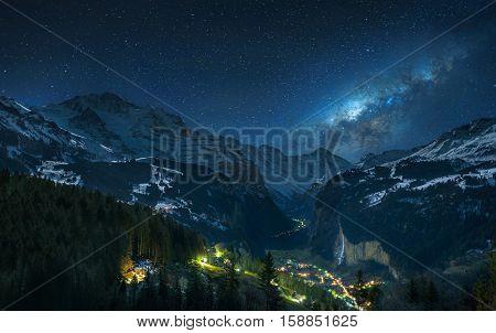 Milky way over fairytale-like Lauterbrunnental and snowy Jungfrau, Bernese Oberland, Switzerland.