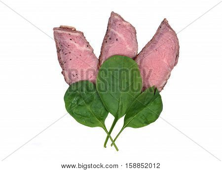 Grass fed juicy corn roast beef with spinach leaves isolated on white background