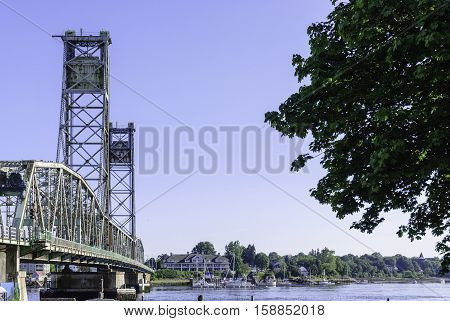 Portsmouth New Hampshire USA - August 9 2009: The original World War I Memorial Bridge over the Piscataqua River between Portsmouth New Hampshire and Kittery Maine before the center span was replaced in 2012