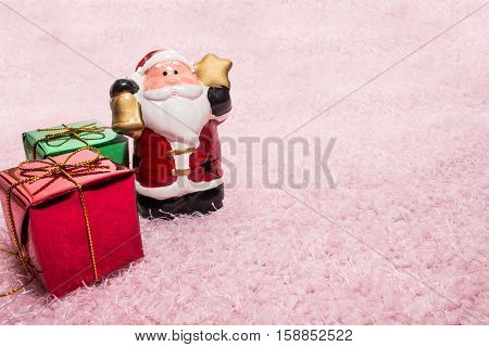 Santa Claus doll and gift box for christmas. The Accessories for Christmas tree.