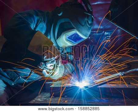 welder craftsman erecting technical steel Industrial steel welder in factory