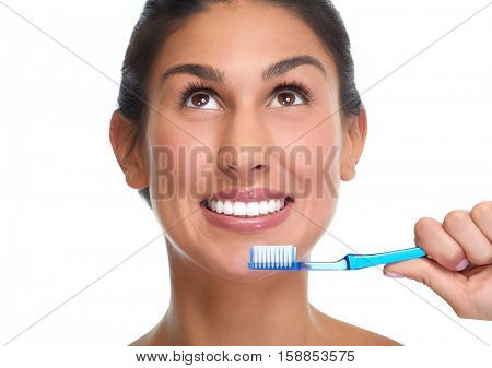 Smiling woman with toothbrush.