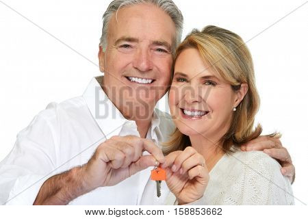 Senior couple with house key.