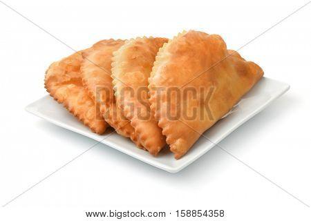 Chebureki on the plate isolated on white