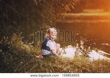 girl walking in the park near the river