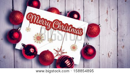 White and red greeting card against white wooden background