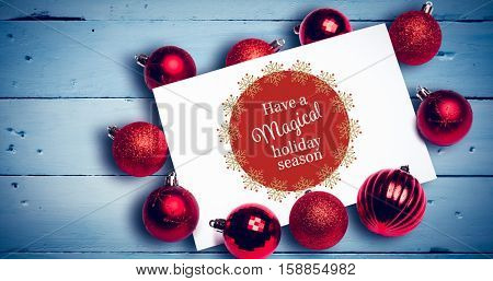 White and red greetings card against bleached wooden planks background