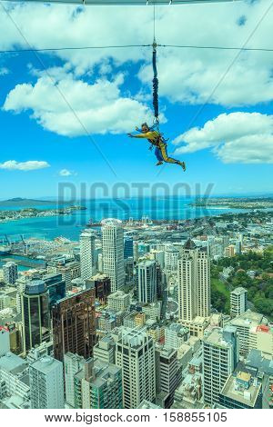 Auckland New Zealand- December 12 2013. A man bungee jumping from Auckland sky tower.