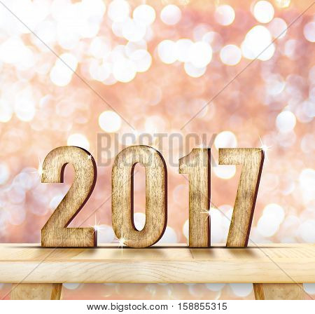 2017 year wood number on wood table with pink sparkling bokeh wall and wooden plank floorleave space for adding your content.