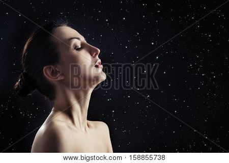 sensual aroused woman profile on stars sky background with copyspace