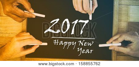 Black board with new year text on wooden background