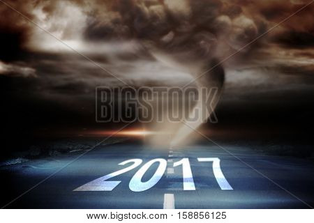 Happy New Year 2017 against 3D stormy sky with tornado over road