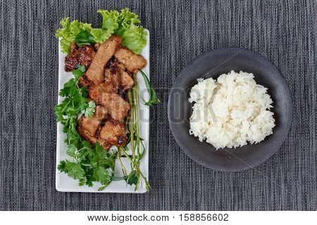 Grilled Pork With Mixed Herb Served Sticky Rice .