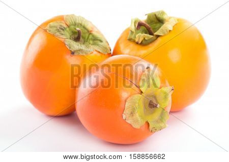 ripe persimmon on a white background