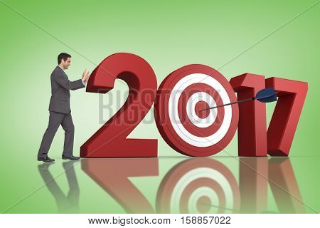 Businessman pushing against green vignette with 3D new year