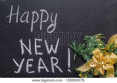 text Happy New Year 2017 on chalkboard, vintage concept