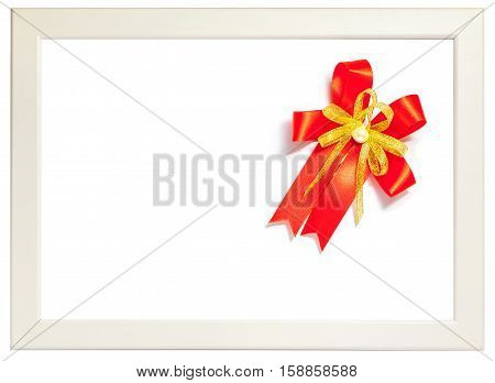 Shiny red ribbon bow decorated on white photo frame season greeting concept. (left space for text)