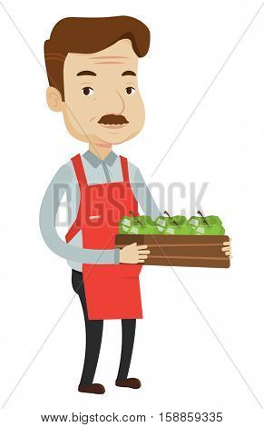 An adult worker of grocery store holding a box with apples. Friendly caucasian worker of grocery store standing with crate full of apples. Vector flat design illustration isolated on white background.