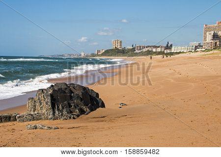 Empty Beach Against City Skyline And Blue Sky