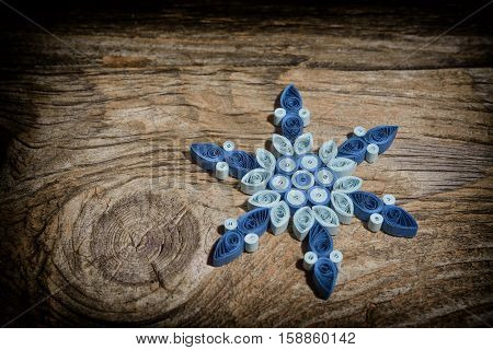 Christmas background with snowflakes on wooden table