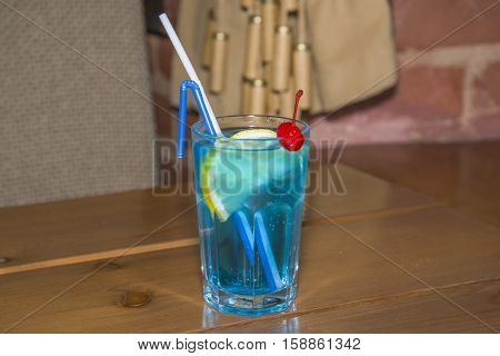 Blue Alcoholic Cocktail In The Faceted Glass.