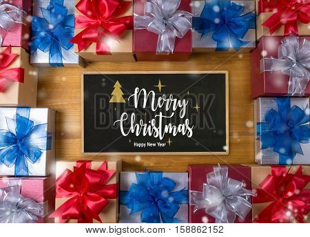 Box Gift  And Small Gift Wrapped , Presents And Christmas , Blank Blackboard Close Up, Top View, Gif