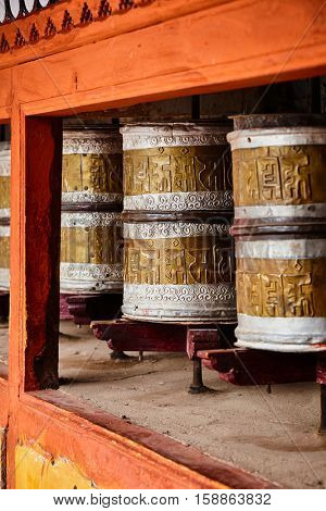 Buddhist prayer wheels in Hemis gompa (Tibetan buddhist monstery). Ladakh, India