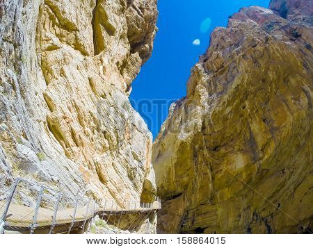 Beautiful view of the Caminito Del Rey mountain path along steep cliffs. Andalusia, Spain.