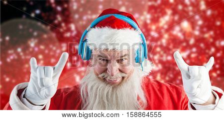 Portrait of Santa Claus gesturing against white snow and stars on red