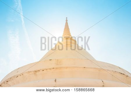 Beautifully decorated stupas at Wat Intharawihan temple, Bangkok, Thailand. Traditional religious architecture, one of the main attractions on Bangkok.