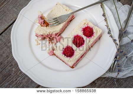 Raw cashew cake (cheesecake) and berries (strawberries cherries) lavender on a wooden background. . Perfect for the detox diet or just a healthy dessert. Love for a healthy raw food concept.