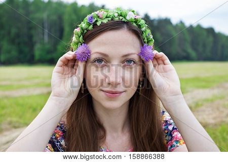 Girl Holding Two Field Flowers
