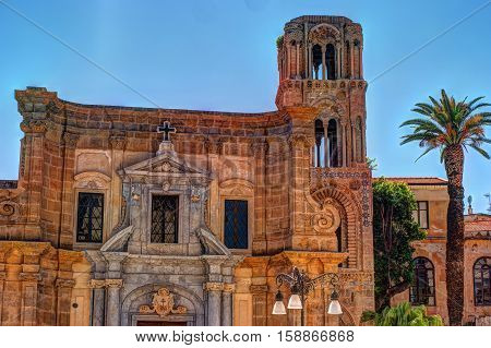 Belltower of church Martorana with palm trees, Palermo. Sicily. Beautiful architecture of the historical district.
