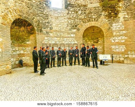 Split, Croatia - May 08, 2014: The male choir singing at the Diocletian's Palace in Split, Croatia. It is well preserved and important popular touristic attraction of Dalmatia on May 08, 2014
