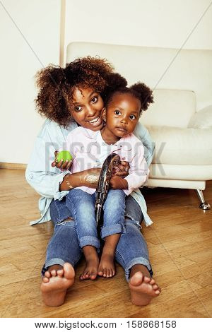 adorable sweet young afro-american mother with cute little daughter, hanging at home, having fun playing smiling, lifestyle people concept, happy smiling modern family close up