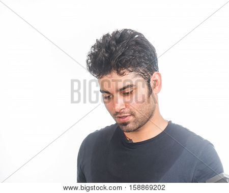 A young Indian South Asian man working out and sweating in a gym - isolated on white