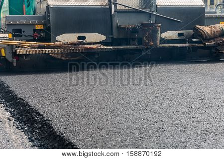 Asphalt paver machine during road construction Road construction and repairing works