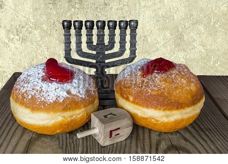 Traditional Jewish sweet donuts, menorah and dreidels are symbols for Hanukkah holiday. Selective focus. Image toned for inspiration of retro style