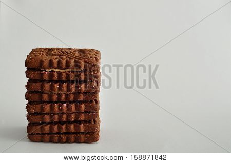 A stack of golden brown biscuits isolated on a white background
