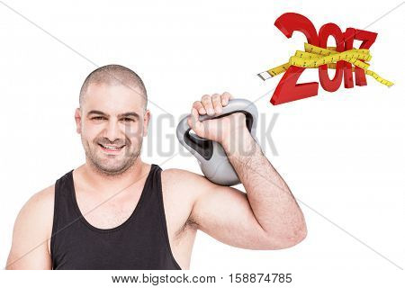 Bodybuilder lifting heavy kettlebell against digitally generated image of 3D new year with tape measure
