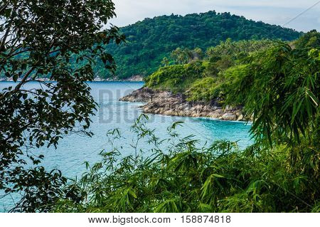View on the rocky shoreline, sea and tropical island nature