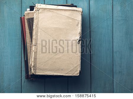 stack of retro folders on old blue wooden background