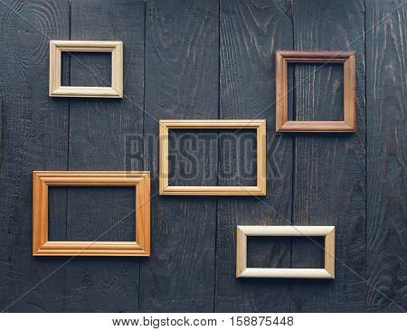 vintage frames on old wooden wall