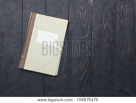 retro folder on old wooden background