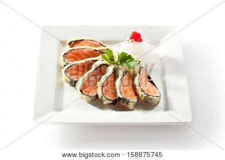 Nori Wrapped Salmon. Garnished with Daikon