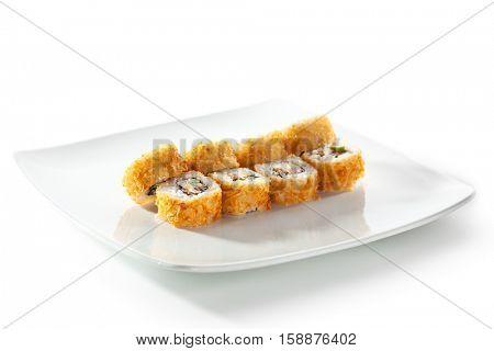 Tempura Maki Sushi - Deep Fried Roll made of Fresh Raw Salmon, Avocado and Cream Cheese inside