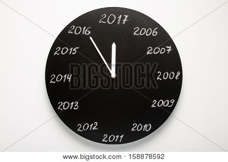 Concept of clock on the eve of 2017. White background.