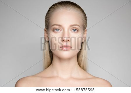 Portrait Of A Beautiful Young Blond Woman With Long Slicked Hair